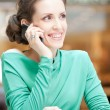 Beautiful business woman talking on cell phone — Stock Photo #32885937