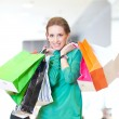 Shopping woman with color bags — Stock Photo #32885957