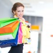 Shopping woman with color bags — Stock Photo #32886013