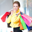 Stock Photo: Shopping woman with color bags