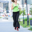 Woman jogging in city street park. — ストック写真