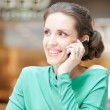 Beautiful business woman talking on cell phone — Stockfoto