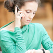 Beautiful business woman talking on cell phone — Photo