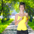 Runner - woman running outdoors in green park — Stock Photo