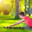 Stretching woman in outdoor sport exercise. — Stock Photo
