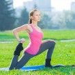 Woman doing stretching fitness exercise. Yoga postures — Stock Photo #32887701