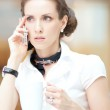 Smart business woman talking on the phone — Stock Photo #32887807