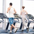 Woman and man at the gym exercising. — Stock Photo #32888377