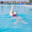 Woman in goggles swimming back crawl style — Stock Photo #32888573