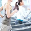 Woman and man at the gym exercising — Foto Stock