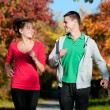 Young man and woman running — Stock Photo