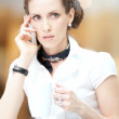 Smart business woman talking on the phone — Stock Photo #32889157