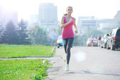 Jogging woman running in city park — Stock Photo