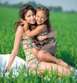 Happy girls on green grass. Playing — Stock Photo