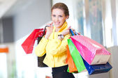 Shopping woman with color bags — Stock Photo