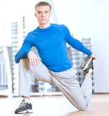 Man doing stretching exercises at the gym — Stock Photo