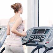 Woman at gym exercising. Run on machine — Stock Photo