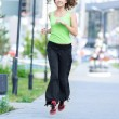 Woman jogging in city street park — Stock Photo