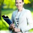 Stock Photo: Business woman with paper folder and pad