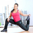 Woman doing stretching exercises at the gym — Stock Photo
