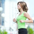 Woman jogging in city street park — Stock Photo #37223019