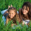 Happy girls on green grass — Stock Photo