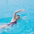 Girl swimming butterfly stroke style — Photo