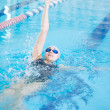 Stock Photo: Girl swimming back crawl stroke style