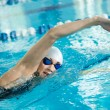 Girl swimming butterfly stroke style — Stock Photo #37223165