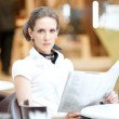 Business woman reading newspaper — Stock Photo #37223251