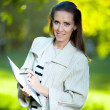Smiling business woman with paper folder — Stock Photo
