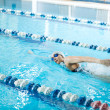 Girl swimming butterfly stroke style — Foto Stock