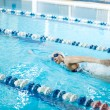 Girl swimming butterfly stroke style — Foto de Stock