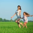 Young happy girls running at green wheat field — Stock Photo #37223365