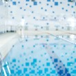 Public indoor swimming pool — Stock Photo