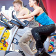 Stock Photo: People in gym doing cardio cycling training