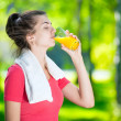 Постер, плакат: Woman drinking fresh orange juice