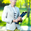 Business woman with paper folder and pad — Stock Photo