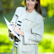 Business woman with paper — Stock Photo