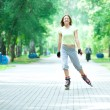 Stock Photo: Roller skating sporty girl in park