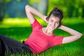 Woman doing strength exercises — Stock Photo