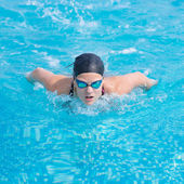 Young girl swimming butterfly stroke style — Stock Photo