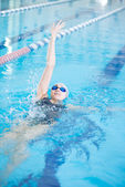 Girl swimming back crawl stroke style — Stock Photo
