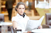 Business woman reading newspaper — Stock Photo