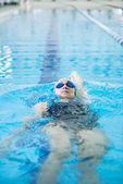Young girl swimming back crawl stroke style — Stock Photo