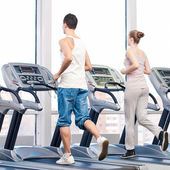 Woman and man at the gym — Stock Photo