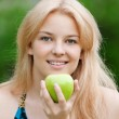 Beautiful woman with green apple — Stock Photo #8534740