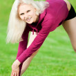 Beautiful woman doing yoga stretching exercise — Stock Photo #8630460
