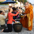 Stock Photo: HUHIN, THAILAND - DEC 28:VictoriAzarenkof Belarus gives food to monks. Before tennis Match Huhin World Tennis Invitation at Intercontinental resort on December 28, 2012 in Huhin, Thailan