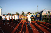 Kawin Thamsatchanan of Thailand holding a flag of Rattana Bundit University in 40th Thailand University Games at Institute of physical education chonburi camp on January 11, 2013 in Chonburi, Thailand — Stock Photo